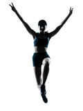 Woman runner jogger jumping victorious. One caucasian woman runner jogger victorious jumping in silhouette studio isolated on white background Stock Photography