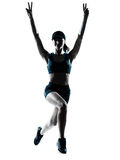 Woman runner jogger jumping victorious silhouette Royalty Free Stock Photo