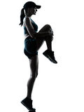 Woman runner jogger stretching warm up Stock Images