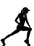 Woman runner jogger stretching warm up silhouette Royalty Free Stock Photo