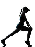 Woman runner jogger stretching warm up silhouette Royalty Free Stock Photography
