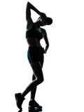 Woman runner jogger tired breathless. One caucasian woman runner jogger tired breathless in silhouette studio isolated on white background Royalty Free Stock Photography
