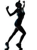 Woman runner jogger tired breathless. One caucasian woman runner jogger tired breathless in silhouette studio isolated on white background Stock Photo