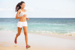 Woman runner jogging on beach Royalty Free Stock Photo