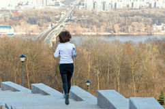 Woman runner jogging with beautiful city view, running outdoors Stock Photos