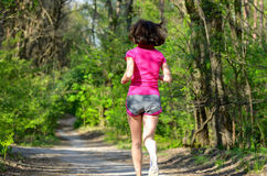 Woman runner jogging outdoors in forest Royalty Free Stock Photos