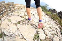 Woman runner legs running on great wall Royalty Free Stock Photos