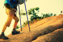 Woman runner legs running on mountain trail Stock Image