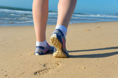Woman runner legs in shoes on beach Royalty Free Stock Photos