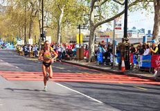 Woman runner at London Marathon 2012. The London Marathon is a long-distance running event, one of the world's largest, held in London, United Kingdom. The event Stock Photo