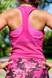 Woman runner in mesh tank top activewear Stock Photography