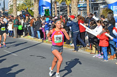 Woman Runner In Marathon Race Royalty Free Stock Photos