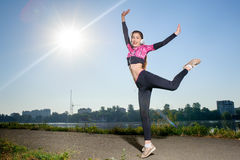 Woman runner outside in city park on sunny day royalty free stock photo