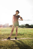 Woman runner in park ready for morning exercise Royalty Free Stock Image