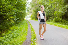 Woman runner rests after workout outdoor Stock Photo
