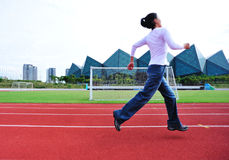 Woman runner running   Royalty Free Stock Image
