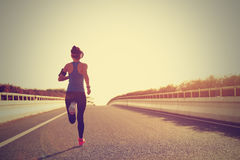 Woman runner running on city bridge road Royalty Free Stock Photography