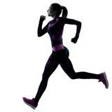 Woman runner running jogger jogging isolated silhouette shadow Stock Image