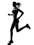 Woman runner running jogger jogging silhouette. One caucasian woman runner running jogger jogging in studio silhouette isolated on white background royalty free stock photography