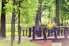 Woman runner running jogging in green summer park and woods Stock Photo