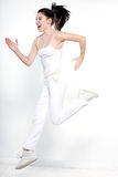 Woman runner running jumping happy. One beautiful young caucasian woman runner running jumping happy on studio  white background Stock Images