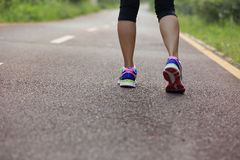 Woman runner running legs at forest trail Stock Photography