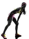 Woman runner running pain muscle cramp  silhouette Royalty Free Stock Photos