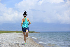 Woman runner running on road Royalty Free Stock Images