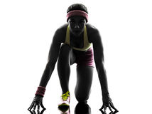 Woman runner running on starting blocks silhouette Stock Image
