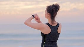 Woman runner on the seashore. Weight loss, fitness, workout concept