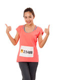 Woman Runner Shows Thumbs Up Isolated On White. Stock Photos