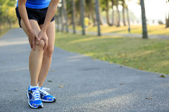 Woman runner sports injured knee Royalty Free Stock Photo