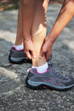 Woman runner sports injury Royalty Free Stock Image