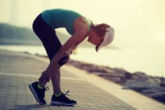 Runner with sports running knee injury. Woman runner with sports running knee injury royalty free stock photos