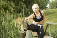 Woman runner stretching Stock Photography