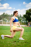 Woman runner stretching Royalty Free Stock Photo