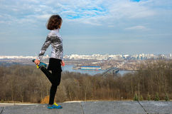 Woman runner stretching with beautiful city view Stock Photography