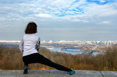 Woman runner stretching with beautiful city view Royalty Free Stock Photos