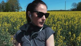 Woman runner stretching hands at the country road stock video