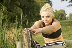 Woman runner stretching hands forward Royalty Free Stock Images