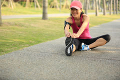 Woman runner stretching legs outdoor Royalty Free Stock Image