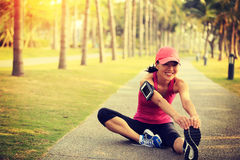 Woman runner stretching legs outdoor Royalty Free Stock Photo