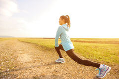 Woman runner stretching legs Royalty Free Stock Photos