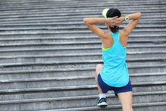 Woman runner stretching outdoor Stock Images