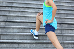 Woman runner stretching outdoor Stock Photography