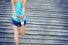 Woman runner stretching outdoor Stock Image