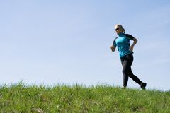 Woman runner training outdoors Royalty Free Stock Images