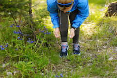 Woman runner tying laces before training. Marathon. stock images