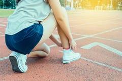 Woman runner tying shoelace royalty free stock image