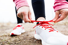 Woman runner tying sport shoes Royalty Free Stock Images